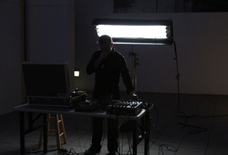 "Terence Hannum in Terence Hannum and Nicolas Lobo's ""Broadcast Against Recording"" performance event at de la Cruz Collection, Miami, Fl, United States, July 9, 2011."