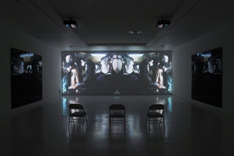 "Terence Hannum, installation view of ""The Badge of Punishment (Featuring Prurient)"" at Light & Sie, 2008. Two-channel video installation with two acrylic panels."